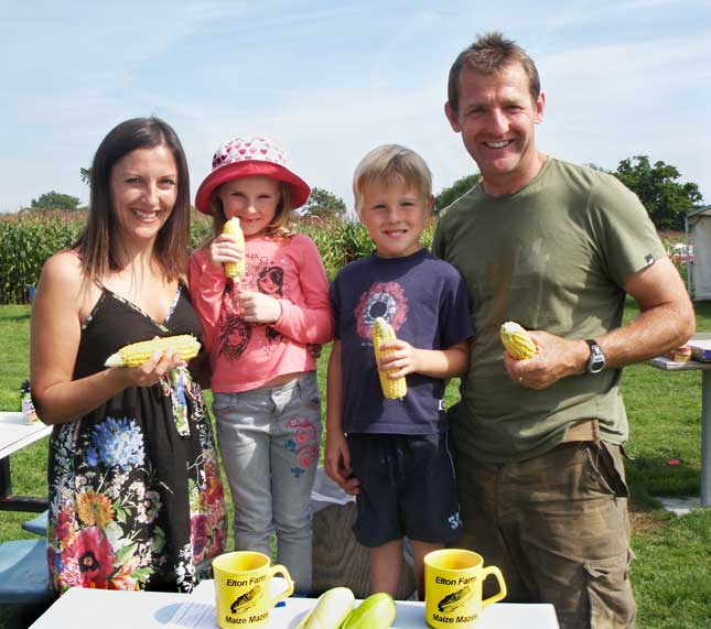 A family with sweetcorn cobs